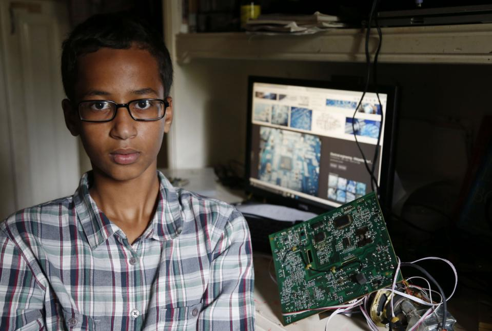 Irving MacArthur High School student Ahmed Mohamed, 14, poses for a photo at his home in Irving, Texas on Tuesday, Sept. 15, 2015. Mohamed was arrested and interrogated by Irving Police officers on Monday after bringing a homemade clock to school. Police don't believe the device is dangerous, but say it could be mistaken for a fake explosive. He was suspended from school for three days, but he has not been charged. (Vernon Bryant/The Dallas Morning News via AP) MANDATORY CREDIT; MAGS OUT; TV OUT; INTERNET USE BY AP MEMBERS ONLY; NO SALES